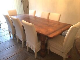 Beautiful dining room table with chairs. Charming feature. Wonderful for entertaining and family.