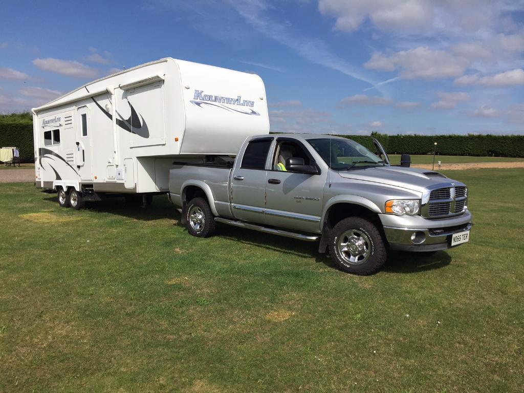 Caravan (5th wheel) and Dodge Ram 5.9 diesel.