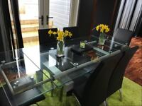 Extending Tempered 12mm Glass dining table with 6 black dining chairs SEATS 8