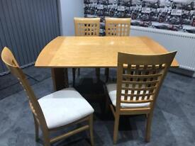 Oak veneered dining table and 6 chairs