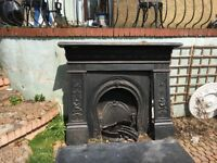 Complete Victorian style cast iron fire place and surround with black marble hearth