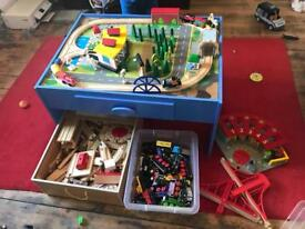 Massive Brio & BigJigs Train Set + table + over 50 trains + Garage + Houses + people. Lots of extras