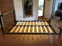 Silver and black metal bed frame