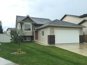 Modern Main Floor Home with Double car garage $1295/month