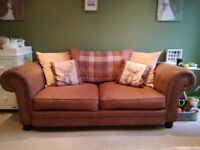3 piece brown leather effect suite with tartan and stag accent cushions, **only 8 months old**