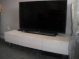 WHITE HIGH GLOSS TV CABINET WITH CHROME FEET AND THREE DRAWERS 5 MONTHS OLD