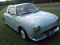 Nissan Figaro convertible, automatic, air con, leather, radio cd player, electric windows.