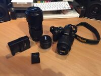 Nikon D3100 with extra lens, handgrip and battery