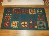 Green patterned rug 133cm x 75cm