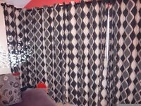 set of black and cream spiral curtains