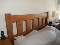 King size wooden bed. Made of stained pine, in great condition.