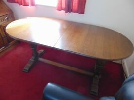 Twin pedestal oak extending dining table Immaculate condition.