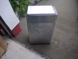 A large stainless steel waste bin in excellent condition