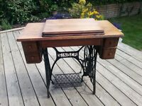Useful little table which transforms into a Singer sewing machine
