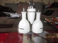 A FOUR PIECE CRUET SET