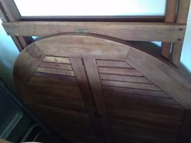 Lovely Next round garden table medium size seats 4 comfortably. Folded very easily . Good condition