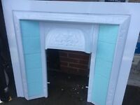 Beautiful fire surround, white with duck egg blue tiles which could be changed .