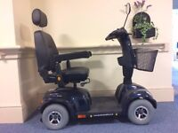 An 8mph, road/pavement legal scooter in black, has had very little use and is in excellent condition