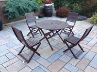 hardwood garden table and chairs as new condition patio seating