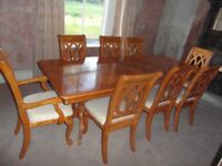 fabulous yew wood 8 seater extending table and chairs and glass cabinet