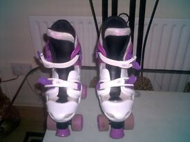 GIRLS ROLLERSKATES ADJUSTABLE FROM SIZE 3 TO 5