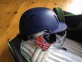 Cricket kit including helmet, pads and bag