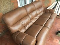 Large brown leather style sofa. Electric recliners.