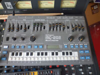 roland mc202 synthesizer with manual and power supply