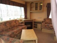 Bluebird Contesa holiday home 12 foot wide and fully double glazed and heated.