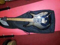 For sale a Wesley electric guitar with carry bag