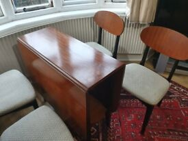 Midcentury drop leaf dining table with four chairs