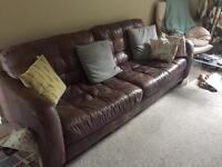 Mauve leather sofa