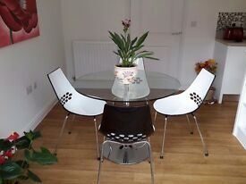 Glass kitchen/dining table and & 4 chairs.