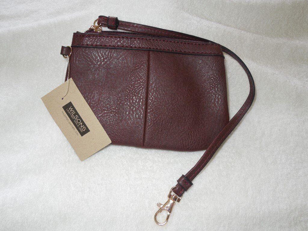 ffde145bbb5b A Genuine Burgundy Wilson Leather Black Rivet Cashwrap Wristlet Bag