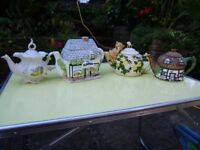Variety of collectible tea pots, figurines, plates