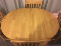 Nice oak wooden extendable dinning table with 4 brown leather chairs