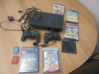 Sony Playstation 2 with 5 games, 2 controllers and 2 8MB memory cards