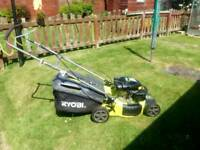 Petrol lawnmower self drive