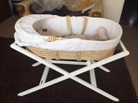 Used Baby's Moses Basket with the stand.