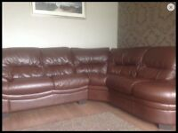 Brown leather corner sofa with swirl chair
