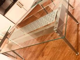 Glass coffee table, quality build and heavy.
