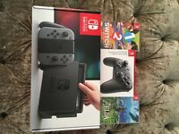 Nintendo switch, Zelda, 1 2 switch, and pro controller.