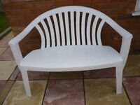 quality white plastic very strong two seater bench,lovely fluted back,only £49.stanmore,middlesex...