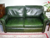 Green leather two seater settee. Good condition.