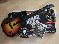 Wii Guitar Hero 5 game and guitar.