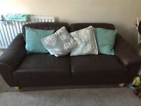 Two small brown leather sofas