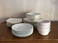 Selection of white plates and bowls.