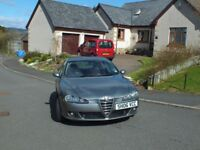Alfa Romeo 147 2.0 TS Lusso in Gun metal Silver with full red leather interior.