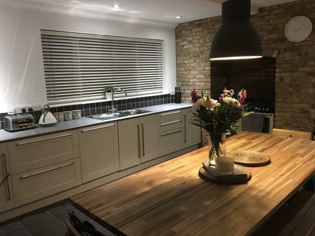 White Gloss Kitchen Units With Grey Worktop In March