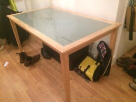 Wooden, glass topped dining table